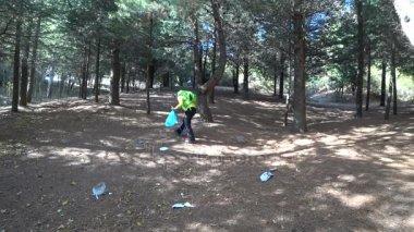 Man picking up trash in nature