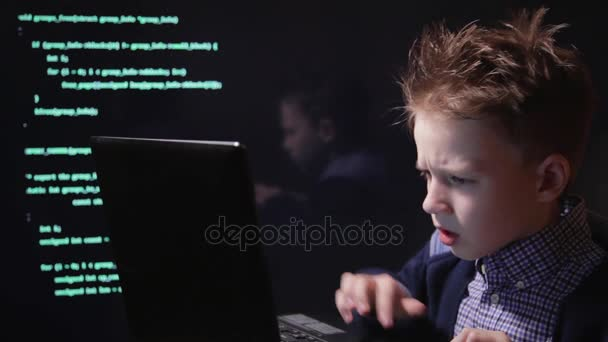 Young schoolboy prodigy - a hacker. Hacker at work.