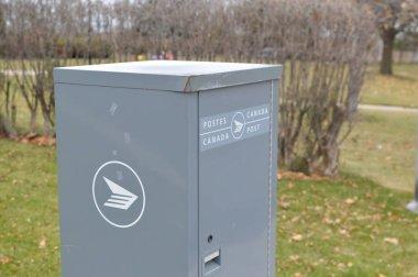 Montreal, Canada - November 24, 2017: Gray Canada Post mailbox on the street.