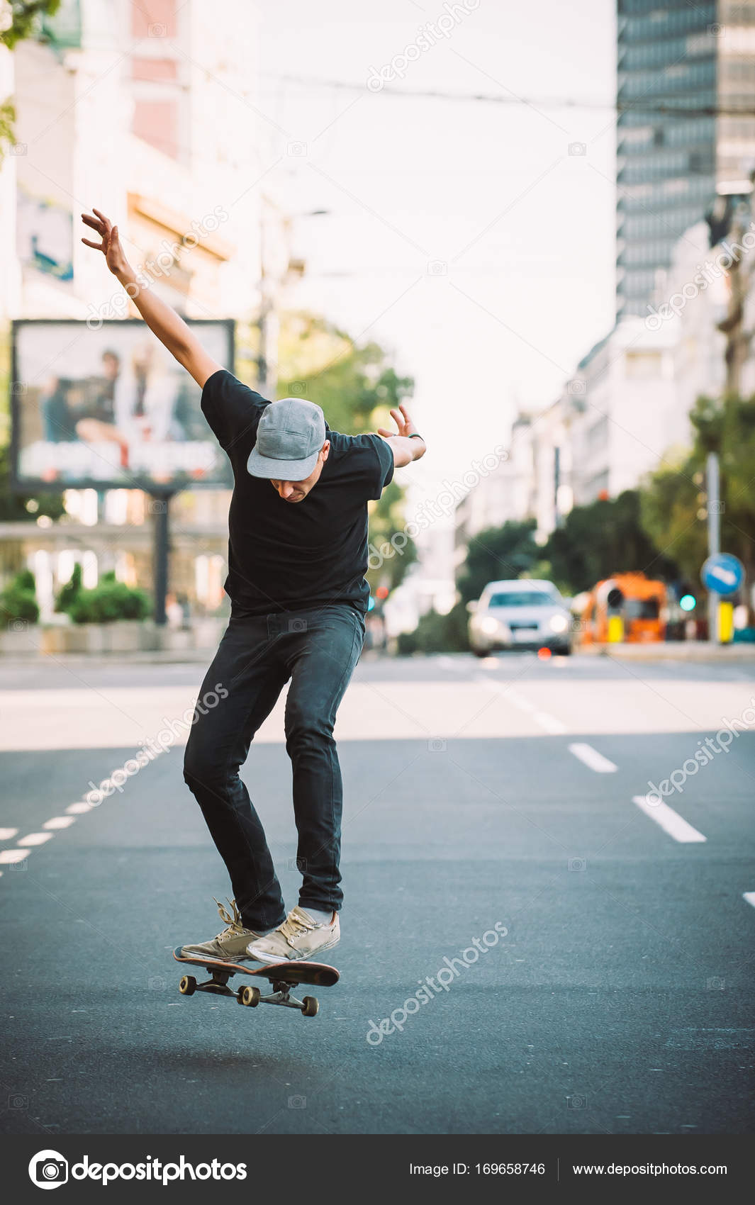pro skater doing tricks and jumps on street free ride stock photo