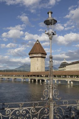 Lucerne with wooden bridge called chapel bridge