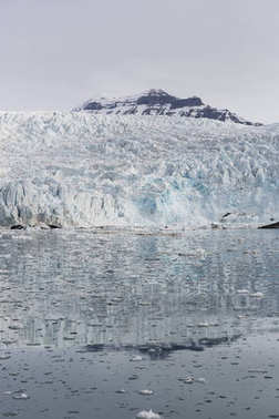 Sea bay with a glacier and icebergs in Svalbard, Spitsbergen, No