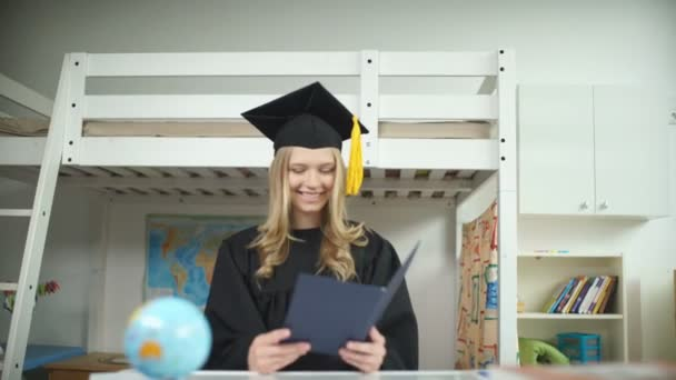 A graduate in the Masters cap and gown. Diploma of Higher Education