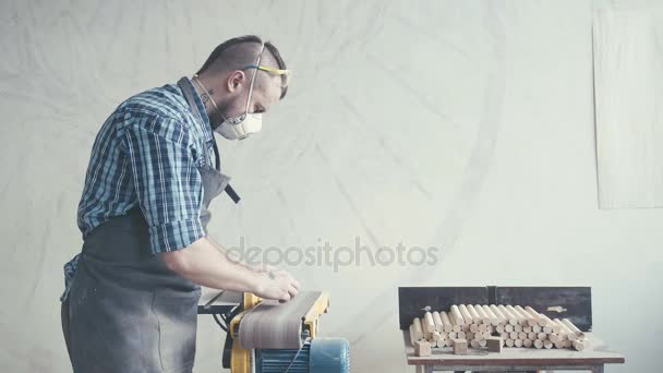 Joiner labouring in mask and glasses for safety. Carpenter with chisel