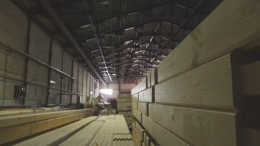 Slats out from under the machine. Wooden sawdust.Woodworking industry