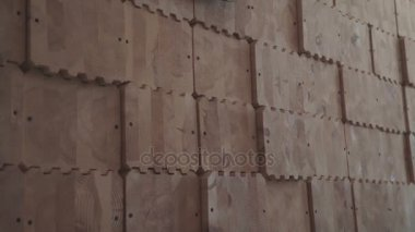 Glued laminated timber in the form of squares with carvings for joints