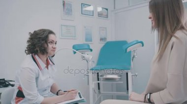 Patient and doctor in the gynecologists office: a gynecological chair
