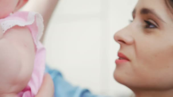 Beautiful young brunette woman with her charming little daughter