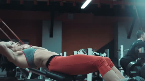 Woman doing crunch exercises for abdominal muscles