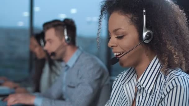 Cheerful woman in call center
