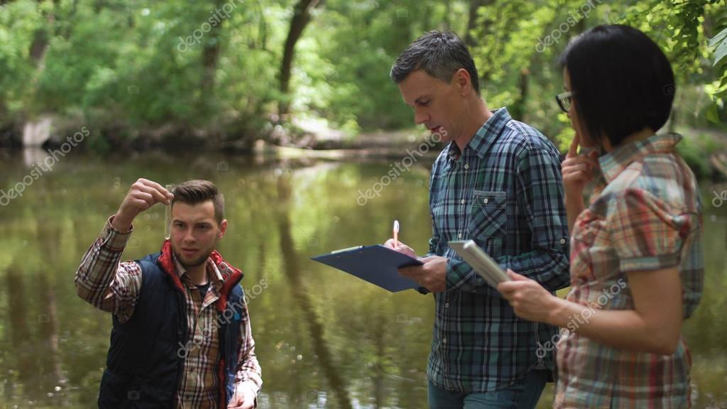 Three scientists exploring water in lake