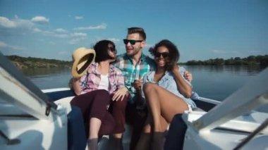 Three friends having fun on boat