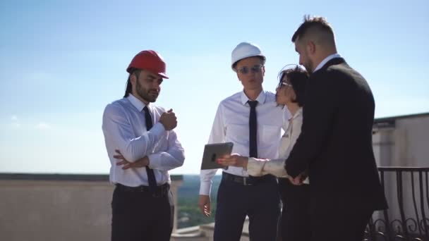 Architects discussing project on rooftop