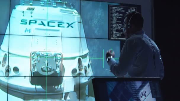 People controlling ship undocking. Elements of this image furnished by NASA.