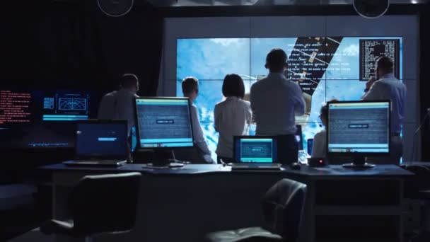 People working in mission control center