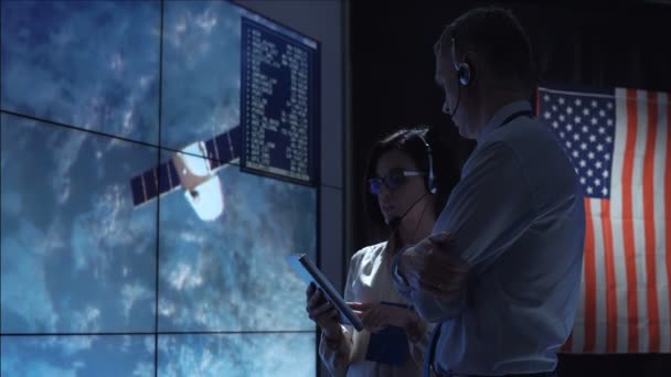People communicating in space flight center