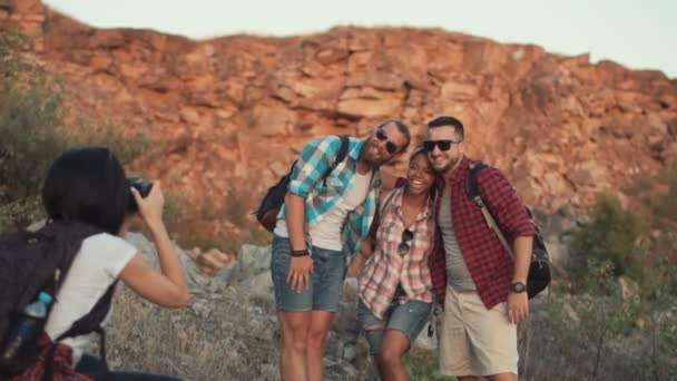 Girl taking photo of friends while traveling