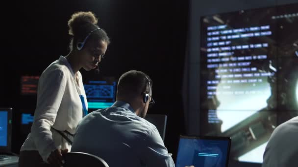 Scientists in flight control center