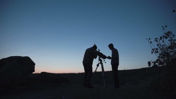 Unrecognizable people exploring space