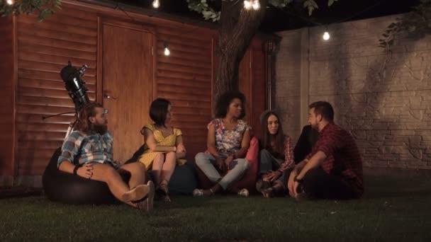 Adult friends talking at night