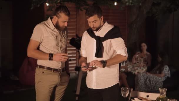 Men talking on party