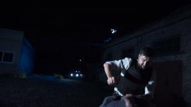 Policeman arresting drug dealer