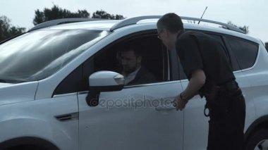 Policeman arresting delinquent