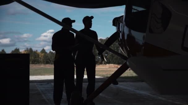 People standing in hangar