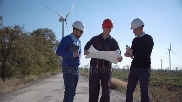 Group of engineers discussing windmill project