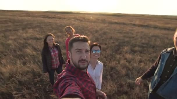 Content youth taking video selfie in countryside