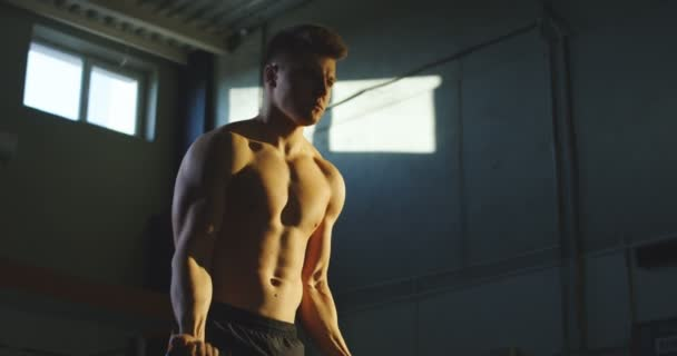 Strong caucasian man lifting kettlebells in gym