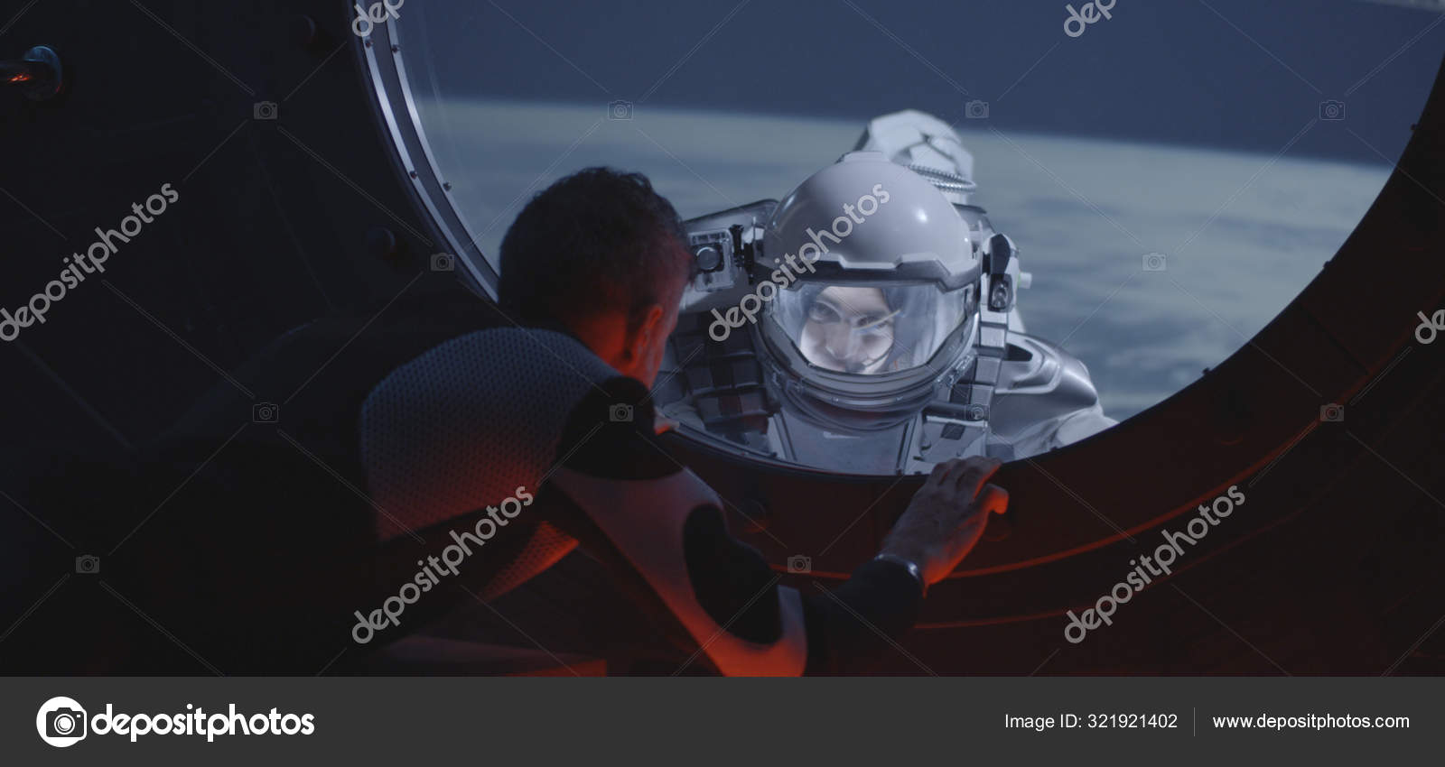 Astronaut talking with spacewalking crewmate