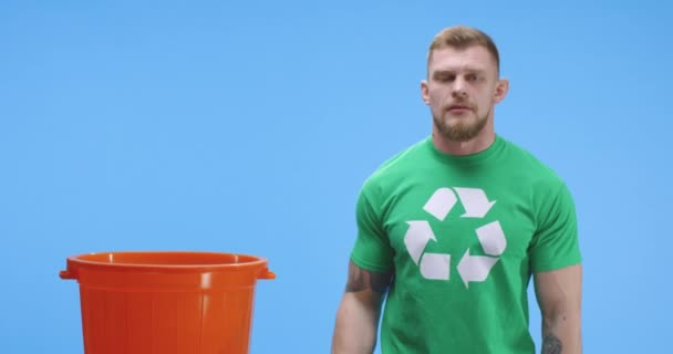 Eco-conscious man putting bottle into bucket