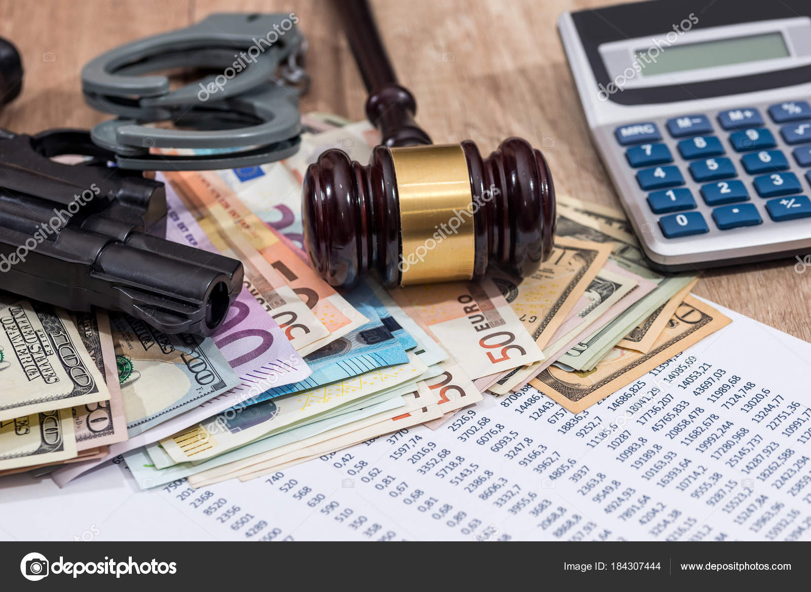 gun hammer handcuffs euro personal budget calculator stock photo