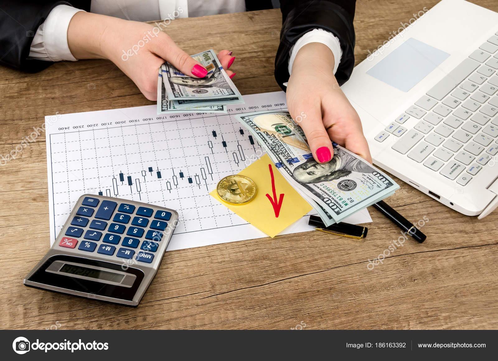 Bitcoin Money Man Laptop Calculator Pen Table – Stock