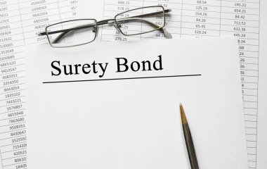 Paper with Surety Bond on a table