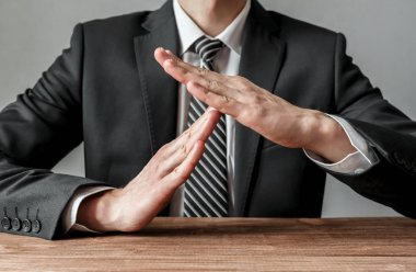 Businessman showing time-out gesture, body language