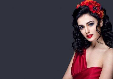 """Картина, постер, плакат, фотообои """"Девочка с красными цветами в волосах"""", артикул 169638914"""
