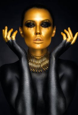 Woman in gold and black colors