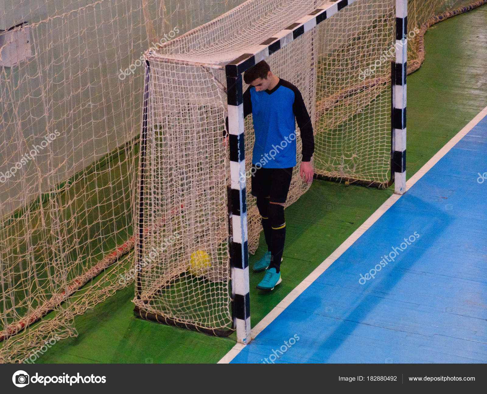 Football Goalkeeper On Goal, Field, Futsal Ball Field In The Gym Indoor,  Soccer