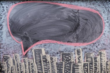 City at night on chalkboard, text balloon or bubble drawn on blackboard
