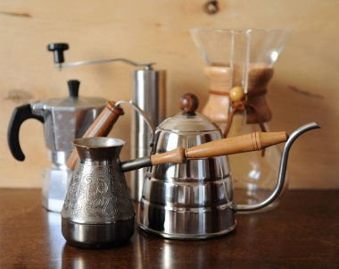 Objects for alternative coffee brewing on a wooden background
