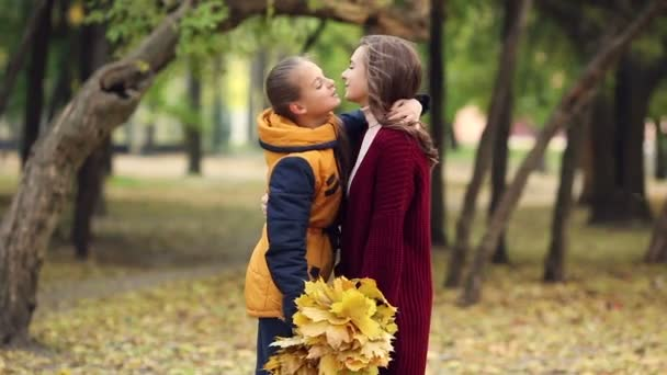 Girls hugging in the park in autumn.