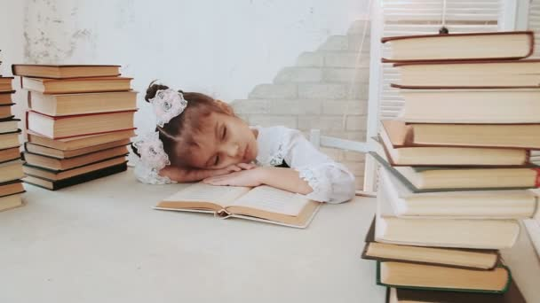 Little girl in school uniform, fell asleep while reading a book.