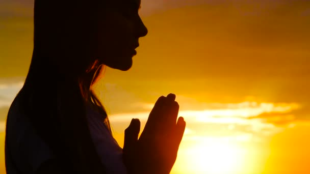depositphotos_157205696-stock-video-silhouette-of-young-woman-praying.jpg