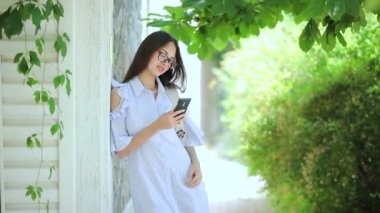 Beautiful girl with long hair makes selfie