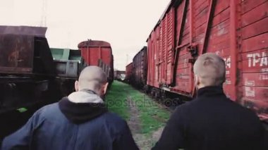 Male athletes running on railroad