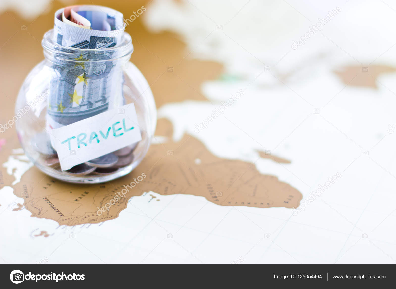 Travel budget vacation money savings in a glass jar on world m travel budget vacation money savings in a glass jar on world map collecting money for travel photo by ferkhova gumiabroncs Choice Image