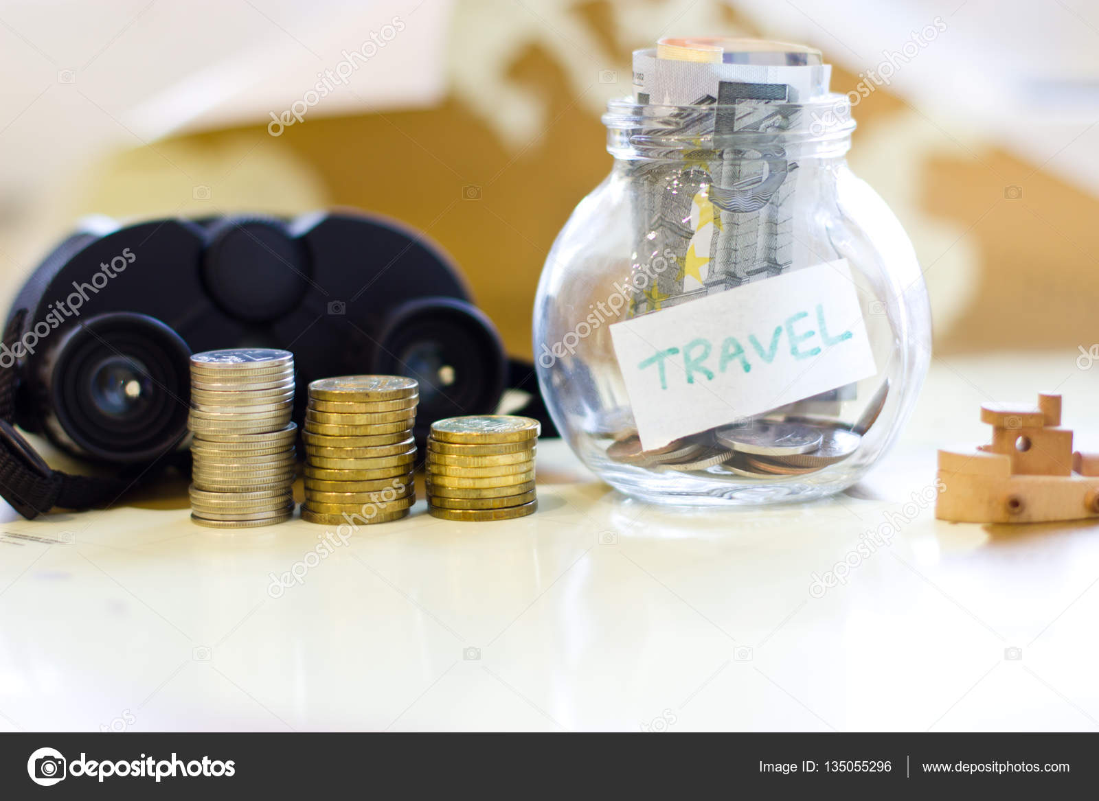 Travel budget vacation money savings in a glass jar on world m travel budget vacation money savings in a glass jar on world map collecting money for travel photo by ferkhova gumiabroncs Gallery