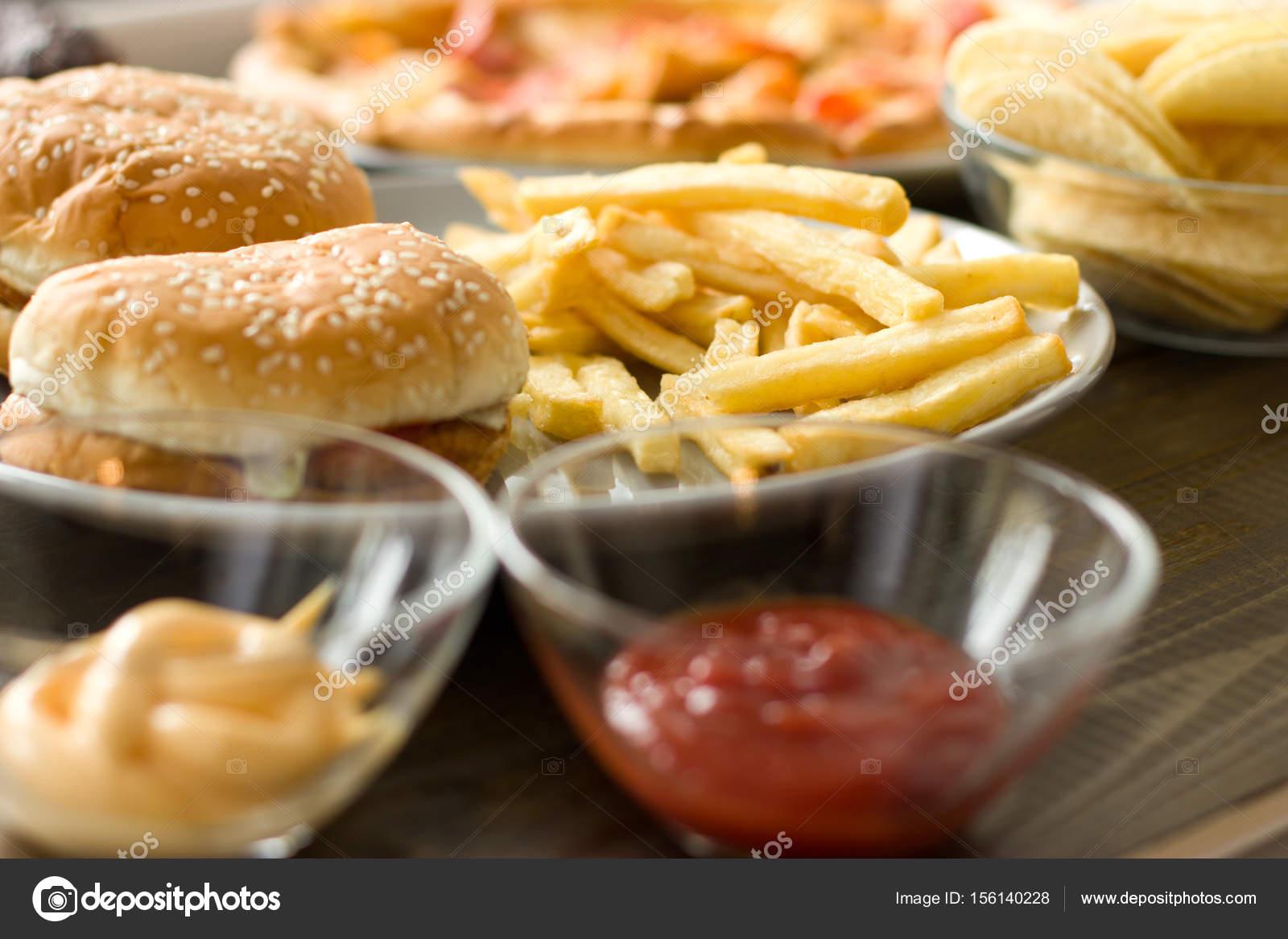 Unhealthy concept  unhealthy food: Burger, sauce, potatoes, donu